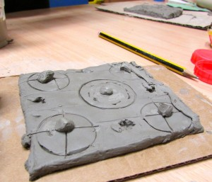 A relief pattern tile made at the children's art school after school club