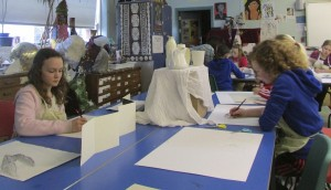 Making still life sketches in the children's art school half term 3D drawing course with artist, Chrys Allan