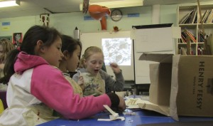 Creating a cardboard box room at children's art school holiday course with artist Chrys Allan