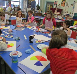 Painting colour wheels at Children's Art School half term painting course led by artist, Karen Logan
