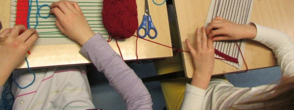 Girls weaving at the Children's Art School after school club led by artist, Karen Logan