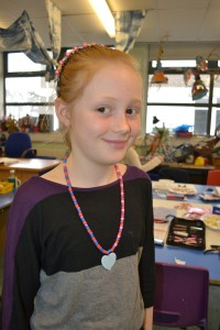 Wearing a necklace made at the Children's Art School holiday jewellery-making workshop with Charlene Braniff